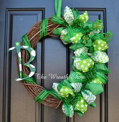 A cute Monogram St. Patricks Day Wreath to hang on your door or as an indoor decoration. Pictured is an 18 wreath, but you can also choose to