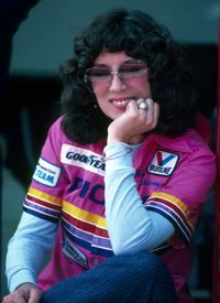 """Shirley """"Cha Cha"""" Muldowney, the """"First Lady of Drag Racing"""", is a pioneer in professional auto racing. She was the first woman to receive a license from the National Hot Rod Association (NHRA) to drive a Top Fuel dragster. She won the NHRA Top Fuel championship in 1977, 1980 and 1982, becoming the first person to win two and three Top Fuel titles. She has won a total of 18 NHRA national events."""