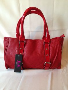 Red Purse.   Available at www.rmfashions.net