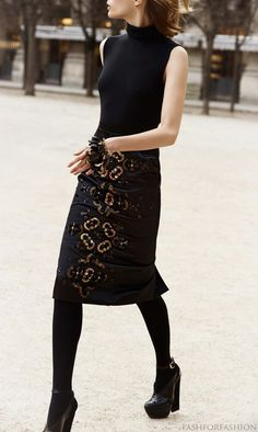 the skirt adding just a hint of shine to an all black outfit. Christian Dior