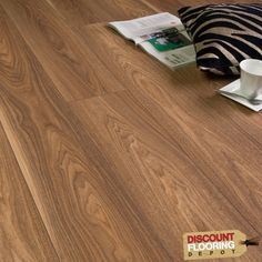 American Walnut 11mm Style Laminate Flooring. Only £10.99 per m2, up to 40% off RRP!