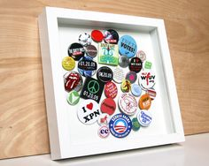 Cute idea:  frame all those random buttons in a shadow box! foam board piece inserted on back to pin on.