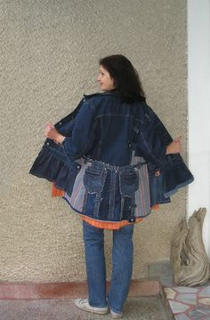 A plain long sleeve denim jacket was refashioned into an asymmetric coat. Very comfy to wear with jeans, shorts or leggings for going shopping or on a walk. The line is lengthen with blue denim and striped denim pieces. The sleeves are shorten and finished with piece from the original bottom
