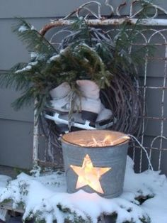 outdoor metal bucket with holiday lights - Junkmarket Style