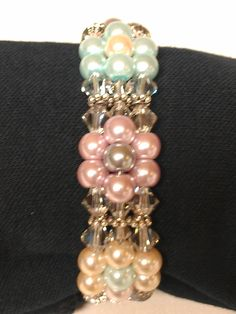 "Three strand pearl and swarovski  crystal bracelet from ""off the beaded path"" YouTube tutorial"