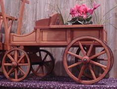 Amish Old Fashioned Buckboard Wagon - Medium Premium Wagon & Wheelbarrow Collection Change your garden landscape with this fully-functional premium wagon! Handcrafted from fine woods and