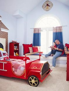 Four-Alarm Fun - A little boy with a big firefighting obsession can sleep easy in this room starring a wooden fire truck bed. The designer used solid light blue paint and coordinating wallpaper with a subtle firefighter pattern on the walls, providing a soft counterpart to the room's main color attraction: fire-engine red.