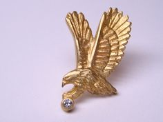 """This 'Eagle-pin"""" was designed and handcrafted, using 18k yellow gold and diamond."""