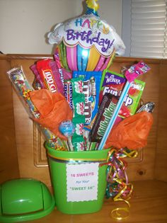 "Sweet 16 Birthday Candy Bouquet - I used a mini plastic trash can for the base/vase (so recipient can use with the lid later) I taped 16 different types of sweets/candies to wooden skewers and inserted into floral foam inside can, added glass gems to bottom for heaviness, added some tissue paper flowers on skewers and a mini helium bday balloon, curling ribbon and a computer printed Birthday sign taped to front ""16 SWEETS FOR YOUR SWEET 16"""