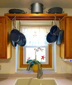 Photo Of Make use of space over the kitchen sink with this DIY pot rack