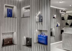 """Niches cut into zig-zagging concrete surfaces display leather accessories """"like artefacts"""" at Valextra's David Adjaye-designed space in Harrods"""