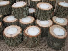 Rustic Wedding Decor Logs Tealights 7 Hour Candles. $55.20, via Etsy.