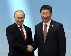 Russian President Vladimir Putin, left, shakes hands with Chinese President Xi Jinping before the opening ceremony at the Expo Center at the fourth Conference on Interaction and Confidence Building Measures in Asia (CICA) summit in Shanghai Wednesday, May 21, 2014. (AP Photo/Mark Ralston, Pool) ▼21May2014AP|China calls for new Asian security structure http://bigstory.ap.org/article/china-calls-new-asian-security-structure-0 #Vladimir_Putin #Xi_Jinping