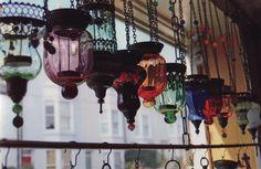 Beautiful Glass Lanterns in a window  ....... via Gypsy Lolita