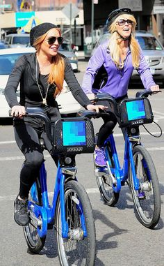 Mommy daughter duo Dina and Lindsay Lohan, both sporting fabulous sunnies, had some fun riding bikes in the Big Apple!