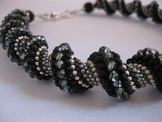 Cellini spiral necklace with black, grays and silver.