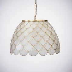 Where natural meets luxe, you'll find our Scallop Capiz Pendant. With its layers of delicate semi-translucent capiz, it naturally filters light, creating a soft glow. Plus, its gilded edges add a touch of shimmering elegance to your space. Capiz Chandelier, Chandeliers, Pottery Barn Kids Backpack, Dreamcatcher Design, Pendant Lighting Bedroom, House Lighting, Gilded Edge, Teen Jewelry, Home