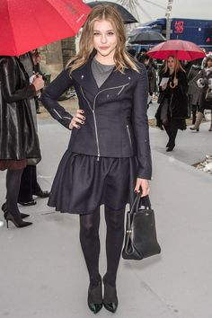 Chloe Grace Moretz in a side zip leather jacket and short black skirt