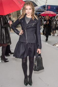 Chloe Grace Moretz in a side zip leather jacket and short black skirt