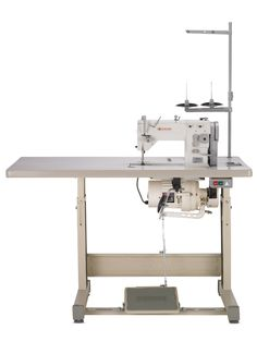 Single Needle Lockstitch Straight and Zig Zag Industrial Sewing Machine. Delivered completely assembled with machine head, single-pedal stand, motor and thread stand