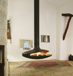 modern fireplaces, hanging fireplace design ideas for contemporary home interiors Suspended Fireplace, Hanging Fireplace, Mounted Fireplace, Floating Fireplace, Contemporary Interior Design, Home Interior Design, Interior Architecture, Modern Interior, Fireplace Design