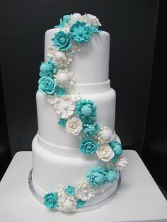 Turquoise wedding cake - would be even better if the white bands were black & some of the white flowers were purple