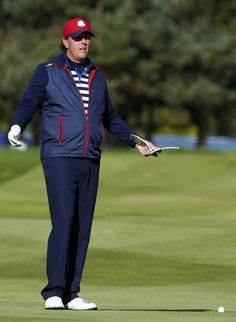 Ryder Cup player Phil Mickelson stands on the 13th fairway during practice rounds