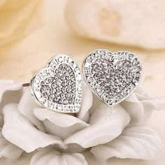 Silver MK Earrings brand new in package! price may be negotiable. Michael Kors Jewelry Earrings