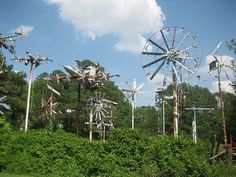 Vollis Simpson's Whirligig Farm in Lucama, NC. One of our favorite art environments so far. Simpson is in his 90s and was still sitting out on his porche welding. These structures are massive, at least 50'/60' tall each. They surround a lake owned by the Simpsons.  Have always loved his work.  Would be fantastic to have a small one mounted on the barn roof!