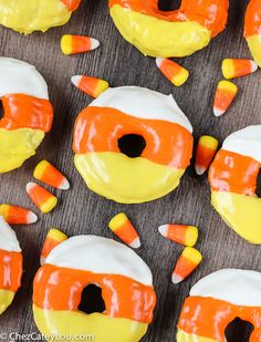 Light and fluffy baked donuts are decorated to look like pieces of candy corn. These Candy Corn Donuts are the perfect Halloween breakfast! Halloween Donuts, Halloween Desserts, Hallowen Food, Halloween Breakfast, Halloween Candy, Donut Recipes, Corn Recipes, Candy Corn, Delicious Donuts