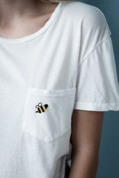 J. Galt USA's boyfriend scoop neck tee in white featuring a small left chest pocket with a bumble bee patch, made in a soft and slight stretch fabric.