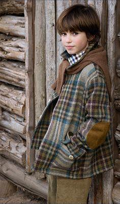 Adorable boy in an equally adorable plaid barn jacket from Oscar De La Renta.