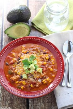 Slow Cooker Chicken Enchilada Soup  - a warm and comforting meal perfect for the weeknight! Let dinner cook in your slow cooker and come home to a flavorful meal! #slowcooker #crockpot