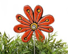 Flower garden art made from ceramic.    Our ceramic plant stakes are fantastic small garden ideas, they also make great gifts. These garden markers add a
