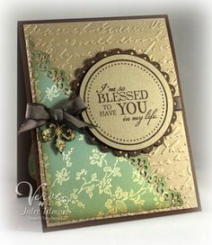 By Julee (Vervegirl). The pretty greenish designer paper is called Everafter from Cosmo Cricket. Card features die-cuts, edger punch, and dry-embossing.