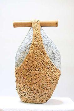 "Stone Bearer  by Deloss Webber  granite, rattan, cane ~ 19"" x 11"" x 10"""