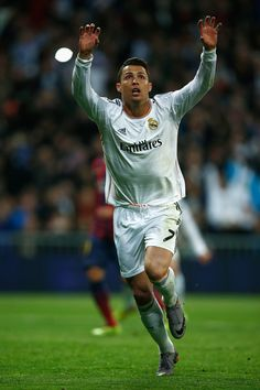 Cristiano Ronaldo celebrates his team's third goal during the La Liga match between Real Madrid CF and FC Barcelona at Estadio Santiago Bernabéu on March 23, 2014 in Madrid, Spain.