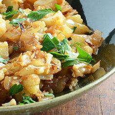 Cauliflower makes a tasty, low-cal substitute for carbohydrates like rice and potatoes. Try this Cauliflower Hash recipe the next time you make brunch. #healthyrecipes #cauliflowerrecipes #everydayhealth | everydayhealth.com