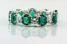 gold-eternity-ring-with-oval-cut-emeralds-and-diamonds