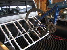 Kayak Storage Truck bike rack idea - pvc piping, to keep all the bikes neat at camp Kayak Storage Rack, Truck Bed Storage, Camper Storage, Bike Storage, Pvc Bike Racks, Truck Bed Bike Rack, Diy Bike Rack, Bike Stand Diy, Bike Repair Stand