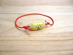 Bracelet with red elastic trim. Fruits. Porcelain charms. Pineapple, Strawberry and Banana.. $13.50, * misako mimoko