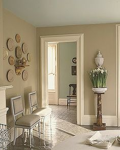 Love the beige color against the softer blue in the next room.