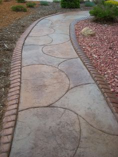 Stamped concrete edging along a decorative concrete walkway. Stamped concrete edging along a decorat Concrete Edging, Concrete Walkway, Stamped Concrete, Decorative Concrete, Concrete Patios, Landscape Borders, Landscape Design, Front Walkway, Landscaping Company