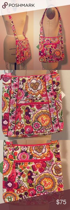 """Vera Bradley Disney Minnie Daisies Crossbody Bag Retired Vera Bradley Disney Minnie Mouse Dancing Daisies crossbody bag. Minnie placement on front and back is in the center (I spent a few minutes looking for the best placement then never used this bag). Measures about 11"""" H x 10 1/2"""" at the widest point x about 1 1/2"""" D. Strap is adjustable from about 27 1/2"""" to 50 1/2"""" and is 1 1/4"""" wide. Vera Bradley silvertone  hardware with fuschia Vera Bradley zipper pulls. From Disney Parks one of her…"""