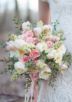 Mixed bouquet of David Austin roses, tulips, roses, tuberose and olive.