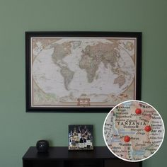 World map that comes with those perfect little red pins for recording your travels - $99.99 on Etsy