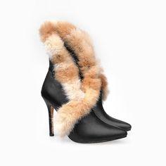 Manolo Blahnik Fur Covering Short Black Boots   http://www.euroshoesdress.com/manolo-blahnik-fur-covering-short-black-boots-p-9647.html