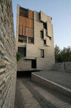 The five-storey structure. Small windows are shielded by triangular stone protrusions, and larger ones have wooden shutters that allow residents to regulate light and temperature levels.