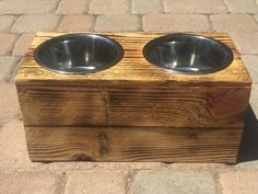 Double XX Large Elevated Dog Dish // XX Large Feeding Stand // Dog Dish // Elevated Dog Bowl. Feed your really big dog in style with our raised dog feeding station. Made from reclaimed up-cycled pallet wood, the stand has been finished with a modified Japanese tradition of shou-sugi-ban. We finish the wood with fire to bring out the grain and seal with a polyurethane to seal and protect. This model holds two 11 inch (five quart) bowls (included). As this is handmade from up-cycled…