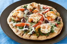 The perfect Friday night dinner for the whole family! Everybody loves to make his own personal pizza, and it's even more fun when it's done on the grill.